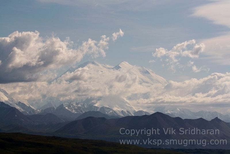 Denali dwarfs all the other mountains in the Alaska Range.  Its peak is over 16,000 feet higher than where I was standing when I took this photo.