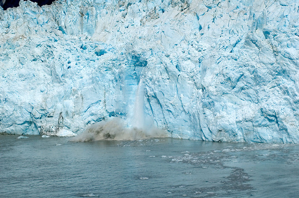 Part of wall of Hubbard Glacier falling into from Disenchantment Bay forming iceberg