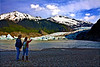 Local Juneau girl in Sitka sneakers, shows her guest Mendenhall Glacier, Near Juneau