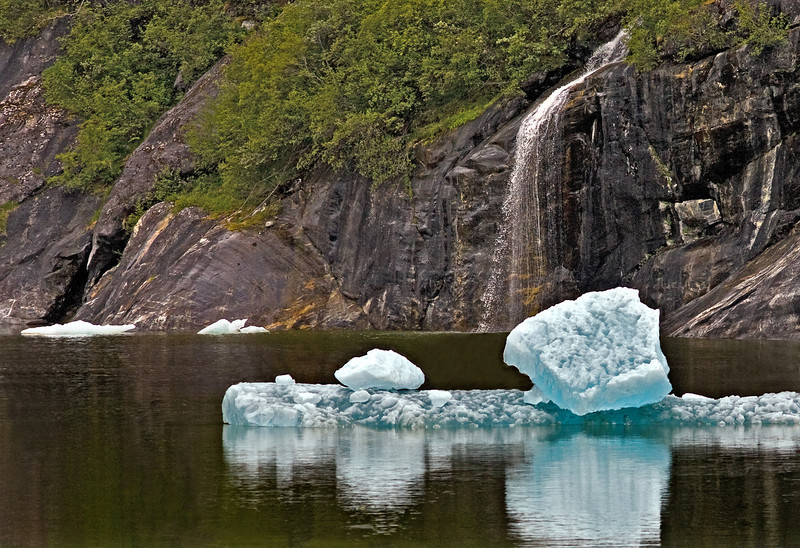 Blue Glacier ice floating by waterfall