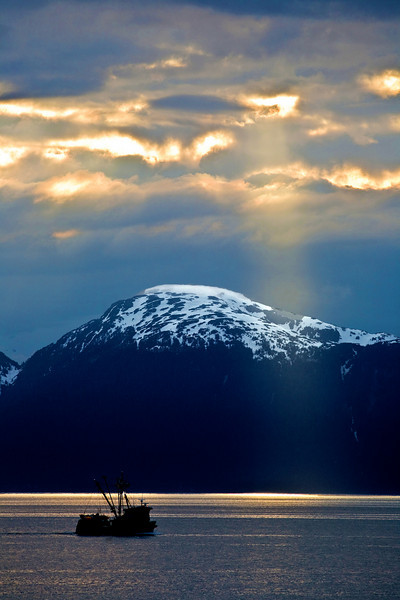 ship sails towards a sunbeam