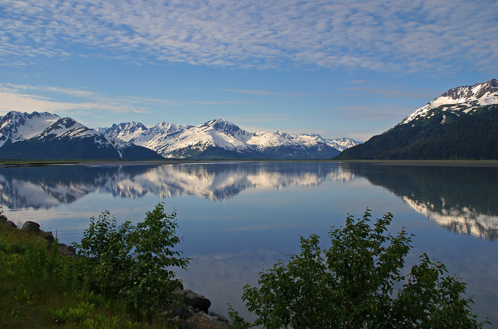 The calm waters of Turnagin Arm reflect the ever present mountains along the Kenai Peninsula.