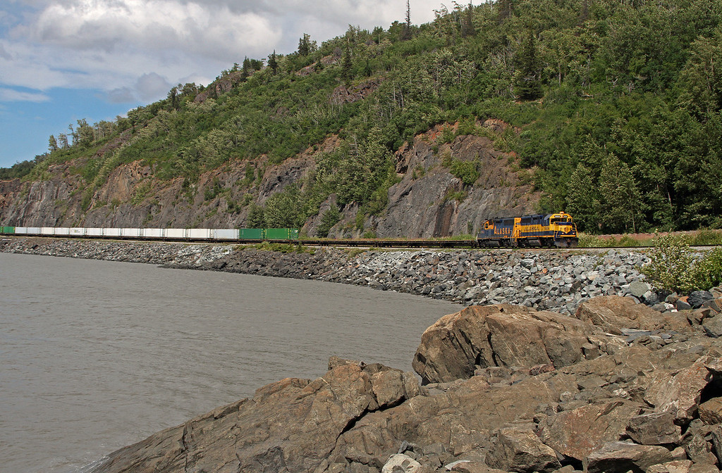 An Alaska Railroad train skirts the shores of Turnagain Arm in their journey south.