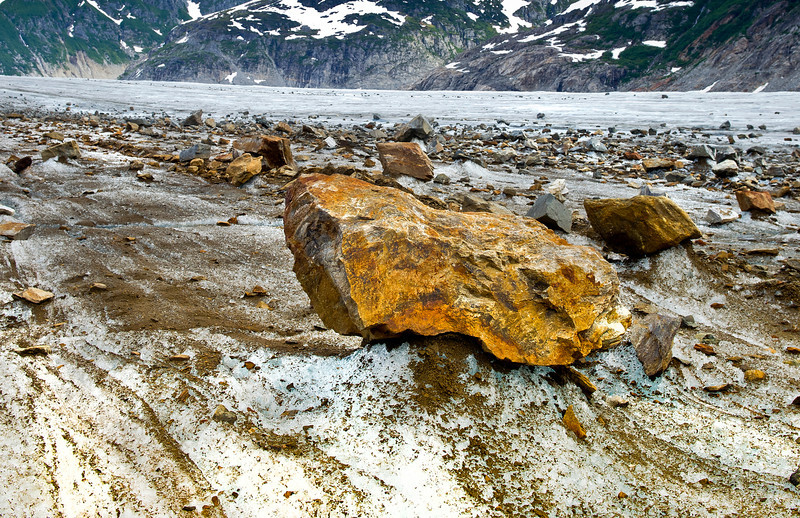 From pebbles to the size of cars, rocks and boulders move on a conveyor belt of ice down the mountain, Meade Glacier near Skagway Alaska
