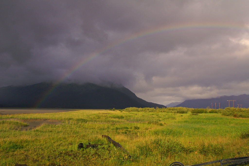 A rainbow appears above Turnagain Arm and 20 Mile River near Portage, AK
