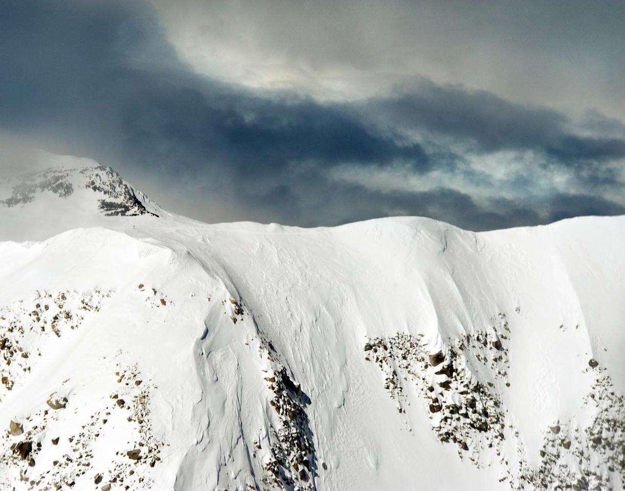 Climber visible at left center on ridge line of Mt McKinley, Denali National Park