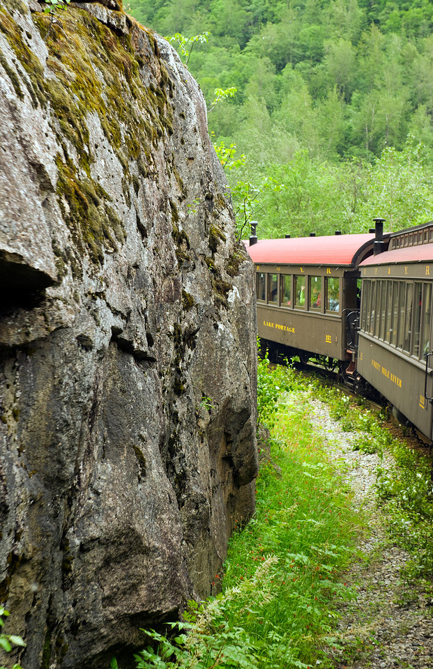 White Pass and Yukon Railroad, so close to the mountain you could almost reach out and touch the cliffs.