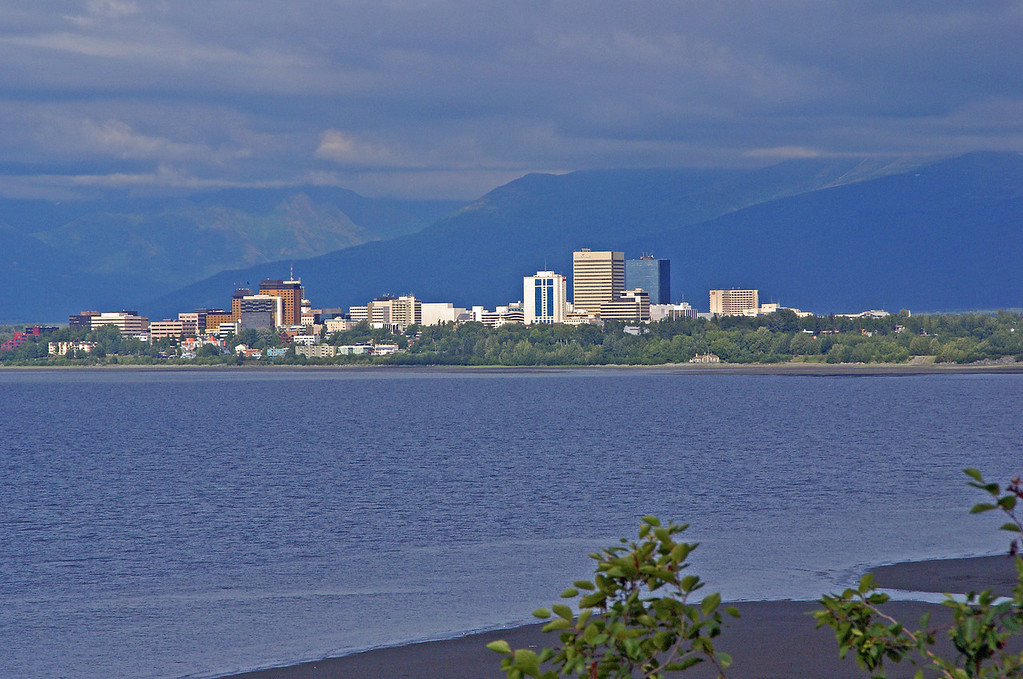 The city of Anchorage sits on Cook Inlet with the Chugach mountains as a back drop.
