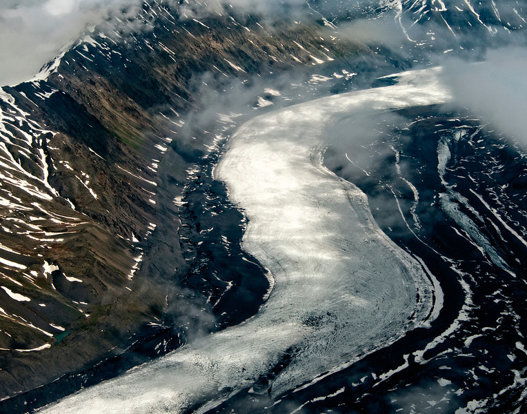 A slow moving S curve of ice carves a valley, Denali National Park
