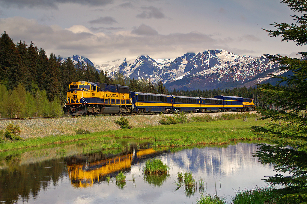 An Alaska Railroad passenger train is near Girdwood, AK as they roll north towards Anchorage.
