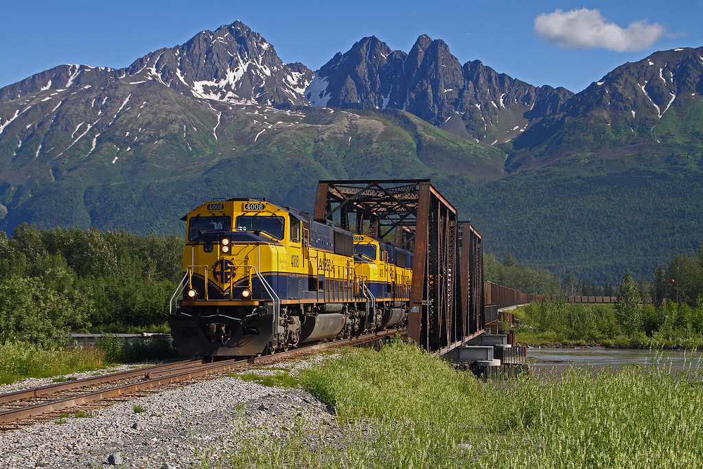 An Alaska Railroad train heads north towards Fairbanks on a very nice summer day seen here crossing the Knik River.
