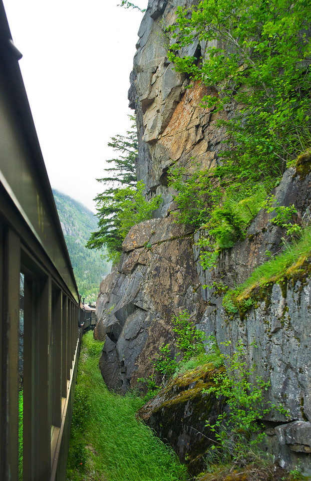 White Pass and Yukon Railroad, another tight squeeze around the cliffs.