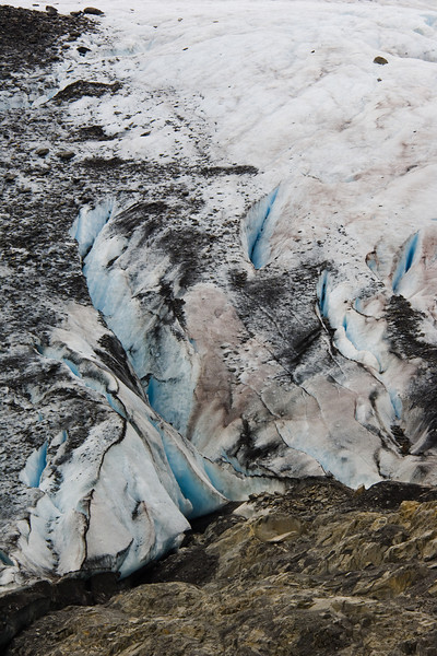 Boundary of ice and rocks, edge of a glacier near the Thompson Pass