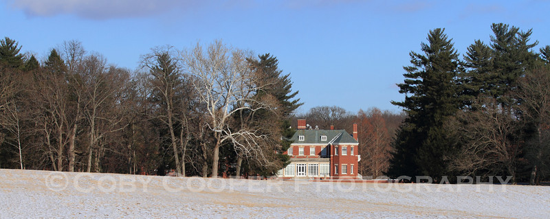 The main house at Allerton across the meadow