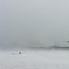 Fisherman in fog on Melchsee