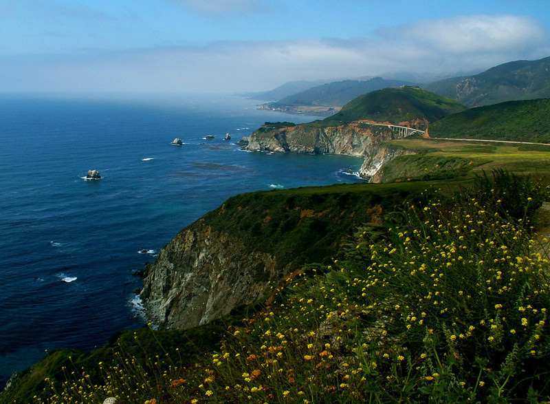 August 2006, showing the Bixby Bridge in the distance along the Big Sur coastline of California.