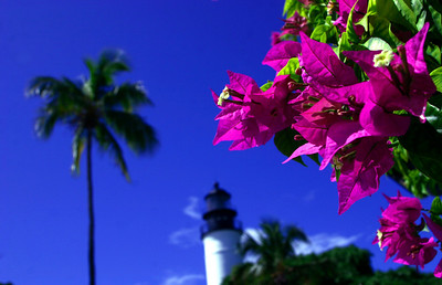 The Key West Lighthouse and Keeper's Quarters Museum: A beacon at the Corner of America  Built in 1847 to aid to ships navigating dangerous reefs off the lower Keys, the Key West Lighthouse now stands sentinel over one of Florida's finest historical sites.   The tower was originally 46 feet high and powered by 15 oil lamps with 15-inch reflectors, but was extended to 86 feet in 1894. Inside visitors now climb 88 iron steps to the observation deck that affords spectacular views.   The tower and nearby Keeper's Quarters have been faithfully restored and maintained as they were before the lighthouse was deactivated in 1969. Many of the historic elements remain, including the pipes used to deliver acetylene gas that powered the light before it was electrified in 1927. The clapboard bungalow where the keepers and their families lived while maintaining the beacon has been recreated in turn-of-the-century style with historic furniture, furnishings and photos that provide a sense of life in Key West during that formative time.   This light station was built after the hurricane of 1846 destroyed the original 1825 tower on the coast. It is the 15th oldest surviving lighthouse in the country.   But as intriguing as the structures themselves are the lives of the keepers who climbed the steps each day to clean and fuel the lamps, especially that of Barbara Mabrity, who took over after her husband died in 1832. She tended the lamps for the 32 years until at age 82 she was fired for making statements against the Union, which controlled Key West and the lighthouse during the Civil War. When a hurricane destroyed the light station in 1846, Barbara Mabrity survived but six of her children were killed after the family sought shelter in the tower.   In 1886 the original keeper's dwelling was torn down and replaced with the present building. After its deactivation, the Lighthouse was acquired by Monroe County. In 1972 it was leased to the Key West Art & Historical Society, which added safety features and opened it to the public in 1989. The keeper's quarters were renovated in 1990 and opened as a museum.   In 1998 the lighthouse was nominated for inclusion on the National Register of Historic Places as a National Historic Landmark, which would put it in the same category as the Washington Monument and the Lincoln Memorial in Washington, DC.