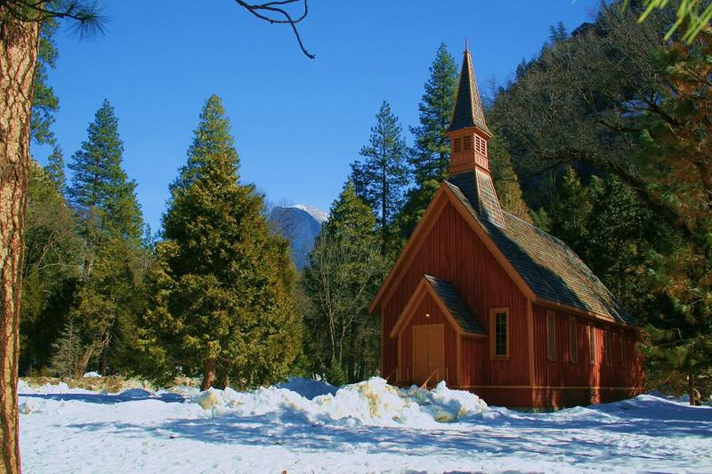 Half Dome seems insignificant in a wide angle photo of the Chapel. February 2008. Snow was about 2 feet deep in most places on the Valley floor, even in wide open spaces. Every now and then my wife sees a good composition that I walked right past. This is one of those, and she gets all the credit for this one.