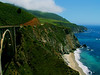 Big Sur California at the Bixby Bridge turnout. It can be calm winds and 85 degrees in San Jose up the road and high fifties here with a biting cold wind.