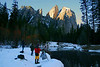 Feb 17, 2008, Cathedral Rock, Yosemite National Park. Photographers gather here beside the Merced River at sunrise for a target rich photo experience, encompassing three of the most inspiring mountain views in the world. From this vantage point are clear shots of Three Brothers Mountain Peaks (behind the camera in this case), El Capitan to the right, and Cathedral Rock shown here. Half Dome is to the photographer's backs and out of view from this spot. The air that morning was perfectly still, cool, crisp and refreshingly rich with oxygen.