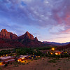 The Watchman towers over the Zion History museum as dusk settles in, Zion National Park