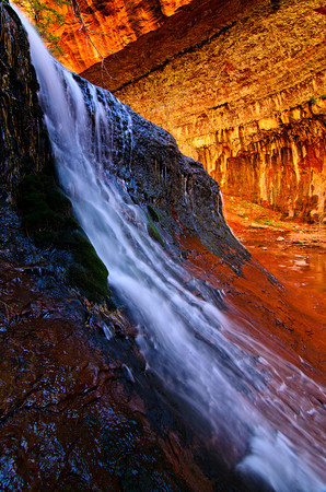 Spring waterflow at the waterfall cascades leading up to the Subway in Zion National Park
