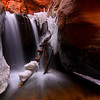 Snow and ice at the upper falls in Kanarra Creek canyon, southern Utah