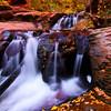 Fall colors at a smaller falls in Kanarra Creek canyon in southern Utah