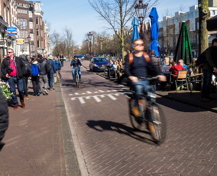 Bicycle riders in Jordaan area of Amsterdam