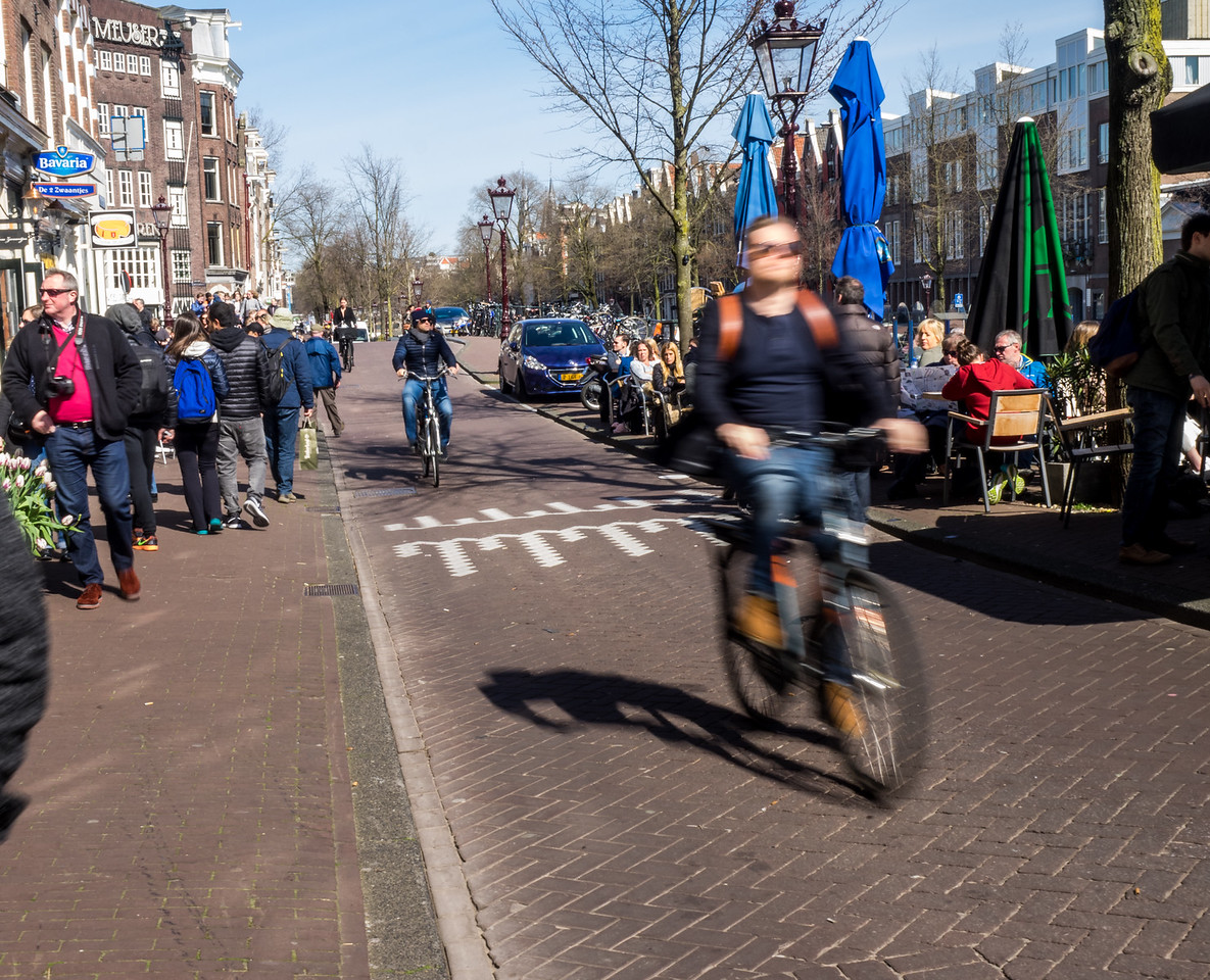 Bicycle riders in Jordaan area of Amsterdam