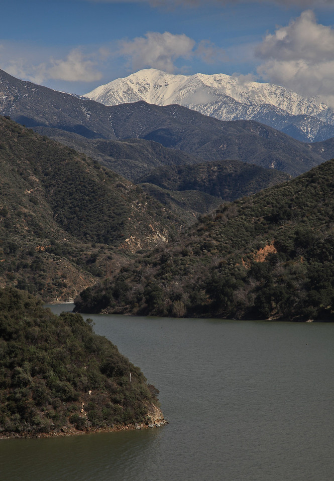 Snow capped Mt Baldy in the distance from the banks of the San Gabriel Reservoir. Angeles National Forest, California.