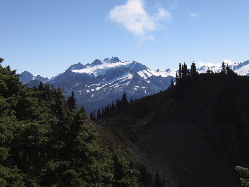 Rounding Bogachiel peak for your first amazing view of Mt Olympus, trail is a tyrail that drops 5000 feet into the valley below the ridge in the foreground after stopping at a beautiful subalpine lake, (Hoh Lake) and going to the Hoh river in the valley at the foot of Olympus.