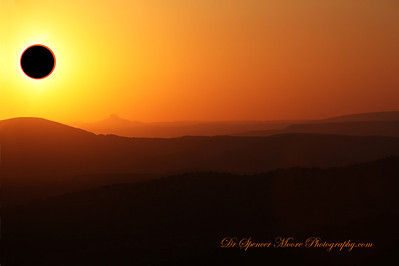 I shot this from the San Pedro Mountain Range outside of Albuquerque NM. This is overlooking the Sandia Mountain Range as the sun set during the eclipse in the distance. We were at 7,000 ft. elevation and as you know you can't photograph the sun without a special sun filter which reduces the light of the sun by over 1,000 times so it doesn't damage the camera's sensor. The foreground shot was taken with my other camera and the two shots have been combined to create what was really there but unphotographable and unviewable with the human eye.
