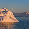 Moonrise and iceberg.
