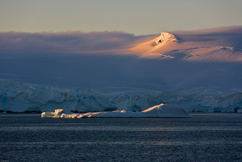 Sunset on Antarctic mountain.