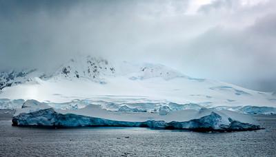 Iceberg in front of glacier