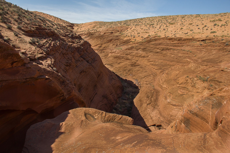 The view down stream from Lower Antelope Canyon gives no hint of the wild colors that bounce off the walls underneath.