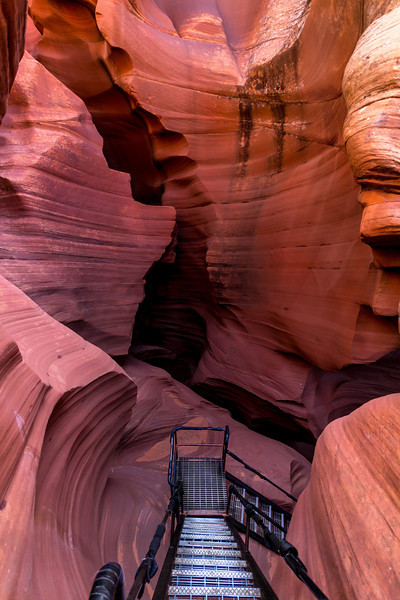 The exit out of Lower Antelope Canyon is an open chamber with a ladder ascent of perhaps 100 feet back to the surface. Five months later a huge flash flood rushed through the canyon and temporarily filled it with violent, churning red muddy water.