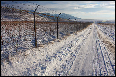 Long fence and road