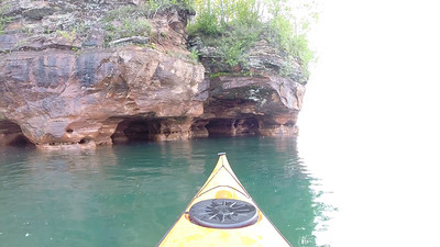 Sand Island- Paddling through Sea Cave. Narrow exit.