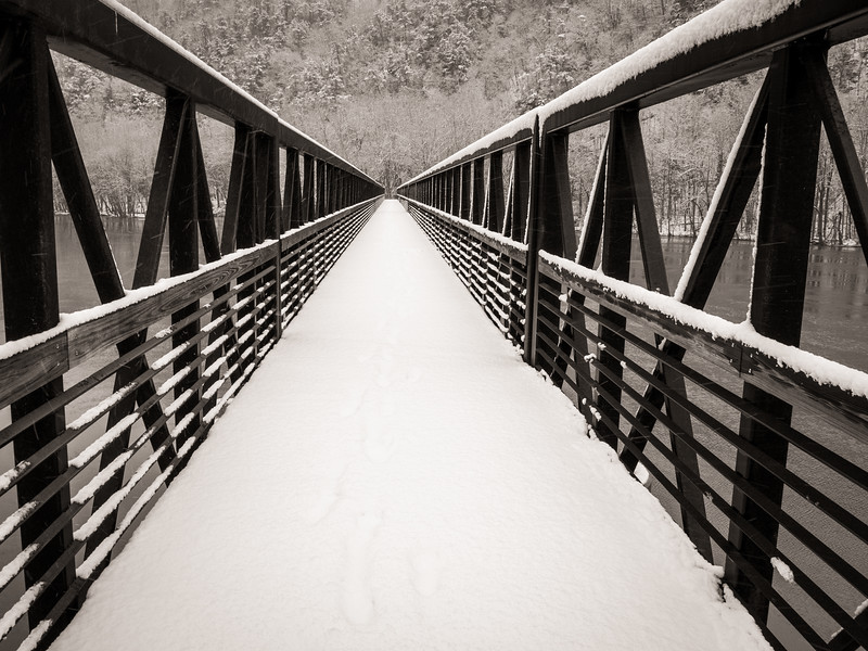 Crossing the Foot Bridge in Winter Storm on the Appalachian Trail just south of route 501 crossing in Virginia. The Foot Bridge spans the James River and is the longest foot bridge on the entire Appalachian Trail.