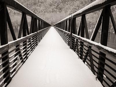 Crossing the Foot Bridge in a Winter Storm