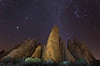 A rock formation, with Orion in the sky