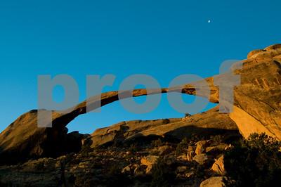 Sunrise Alpenglow & Moon Setting over Landscape Arch, Arches National Park, Utah