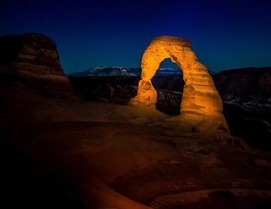 March 19th, 2013 at 8:12 PM. Delicate Arch captured at fading twilight with light paint using a single hand held spotlight from across the bowl. Residual light put the soft glow on the foreground. Settings were ISO 400, 20 seconds at f5.6. I cleared this first with the nearby photographers who were doing time exposures. Distance from the camera to the arch was 250 feet.