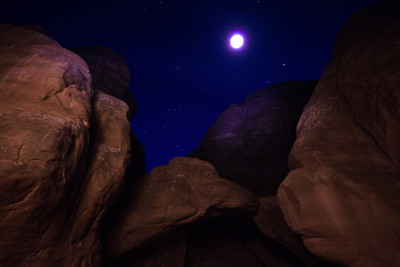 Exposed 20 seconds at ISO 800, f5.6. The overexposed moon is slightly oval due to 10MM wide angle lens perspective distortion. The uniform light on the rocks was accomplished with lots of rapid passes with the directional spotlight on a low power setting using lateral and vertical overlapping patterns.