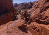 Same trail as the previous photo but looking the opposite direction toward the parking lot. Landscape Arch is up ahead to the right, while Navaho and Partition arches are behind camera to the right on a higher plateau.