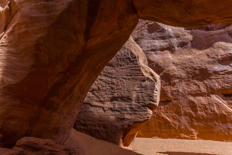 Looking through Sand Dune Arch from the backside.