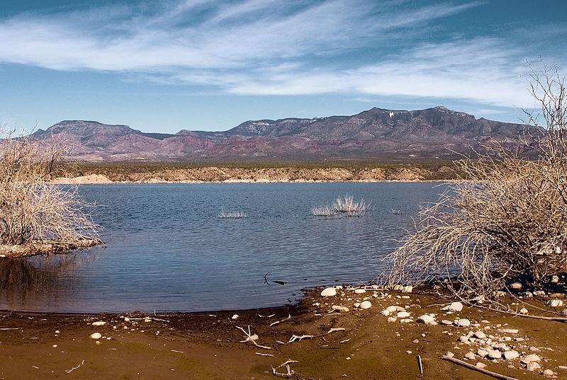 Arizona Lake with mountains and blue sky in the distance