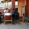 Men sitting in an Arizona saloon drinking beer with an old dog asleep on the floor